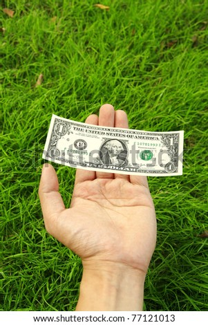 Hand pay dollar for green environment