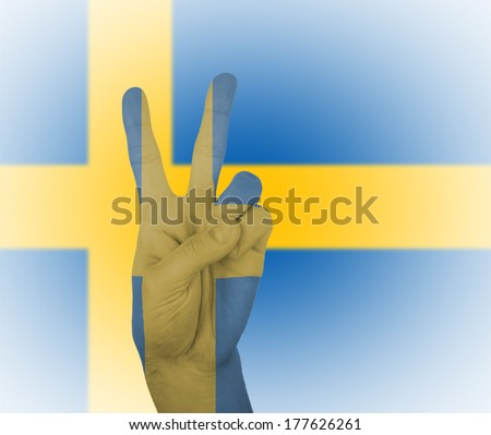 Hand peace sign, wrapped in the flag of Sweden - stock photo