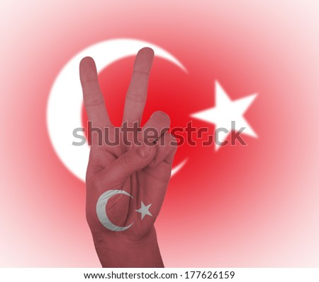 Hand peace sign, wrapped in the flag of Turkey
