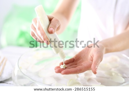 Hand peeling cream . Grained hand peeling.The woman imposes on hand scrub cosmetic
