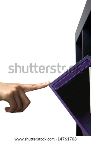 hand picking a book - stock photo
