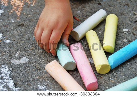 hand picking colored chalk