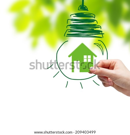 Hand picking green home and bulb sketch  - stock photo