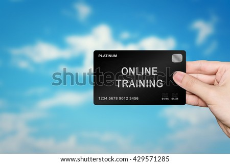 hand picking online training platinum card on blur background