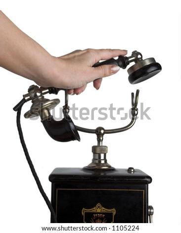 Hand picking up the phone - stock photo
