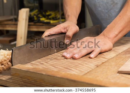 Hand plane/Man using smoothing  plane/select a specific focus - stock photo