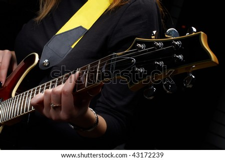 hand play on electrical guitar strings in music study
