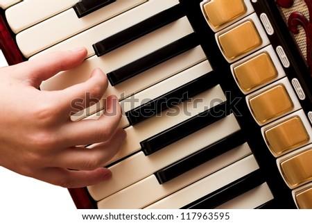 Hand playing accordion closeup - stock photo