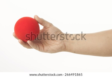 Hand playing with red ball