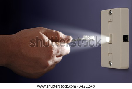 hand plugging an ethernet cable into a glowing port mounted to a wall - stock photo