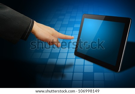 Hand point to digital touch pad - stock photo