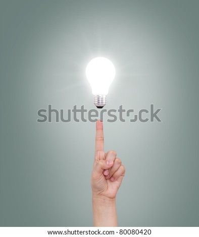 Hand point to Light bulb - stock photo