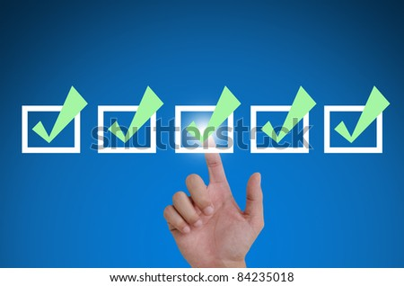 hand pointing a mark the check boxes. on a touch screen interface. - stock photo