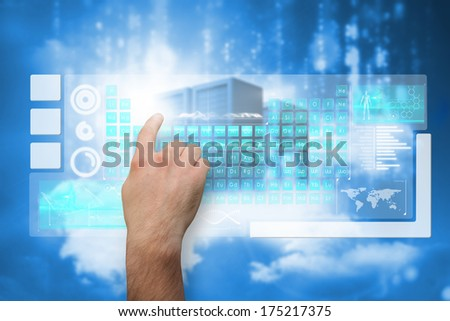 Hand pointing against cityscape on cloud