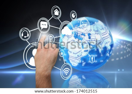 Hand pointing against digital earth background