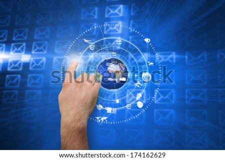 Hand pointing against glowing envelopes on blue background, elements of this image furnished by NASA