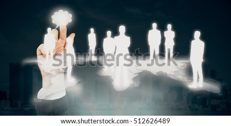 Hand pointing at abstract businessmen silhouettes standing on map. Light city background. International business and partnership concept