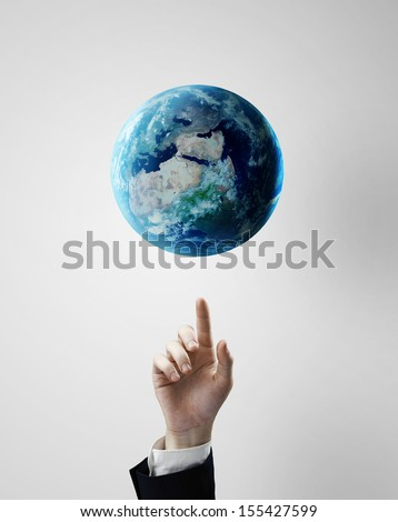 hand pointing at earth, space concept - stock photo