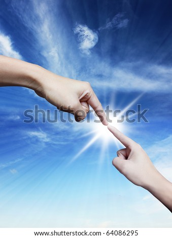 Hand pointing down and up on blue sky - stock photo