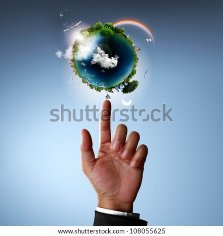 hand pointing glowing earth globe - stock photo
