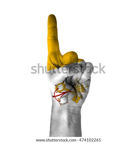 Hand pointing thumb up direction, vatican city painted with flag as symbol of up direction, first and number one symbol - isolated on white background