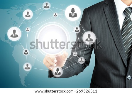 Hand pointing to businesspeople icon network on virtual screen with empty circle in the middle  -can put your texts or pictures inside - stock photo