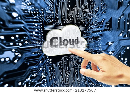 hand pointing to cloud computing symbol on computer circuit board  - stock photo