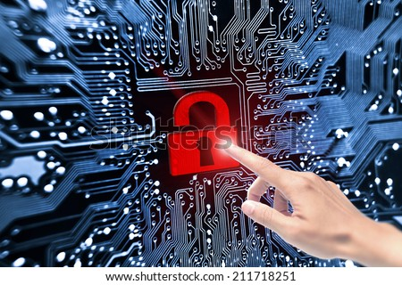 hand pointing to security lock symbol on computer circuit board - stock photo