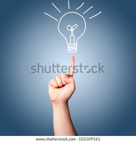 Hand pointing to the hand draw light bulb. Concept for new idea - stock photo