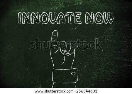 hand pointing up at the concept of Innovate Now - stock photo