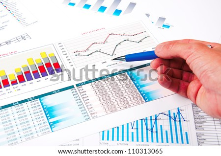 hand points to the growth charts, a picture describing the success of business - stock photo