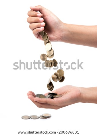 hand pour down coins into hands of another person. - stock photo