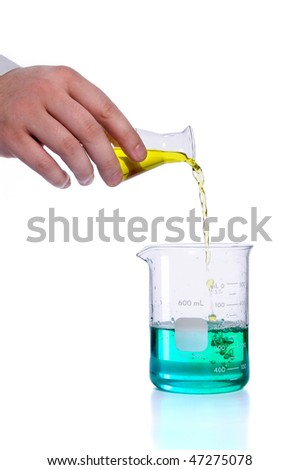 Hand pouring liquid into flak over white background