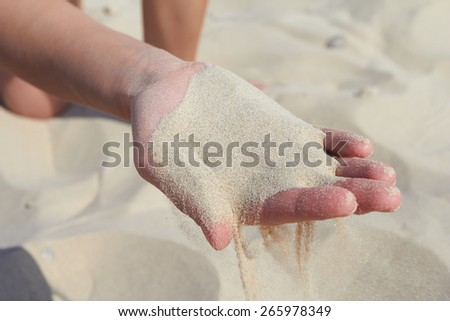 hand pours sand - stock photo