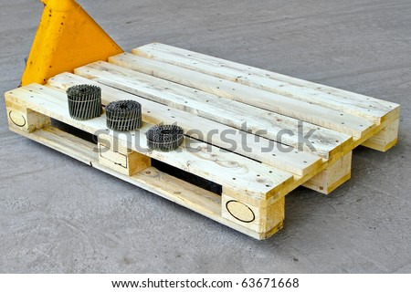 Hand powered pallet jack with nails for production - stock photo