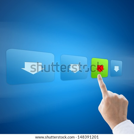 Hand press download button on blue background - stock photo