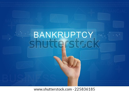 hand press on bankruptcy button on virtual screen - stock photo