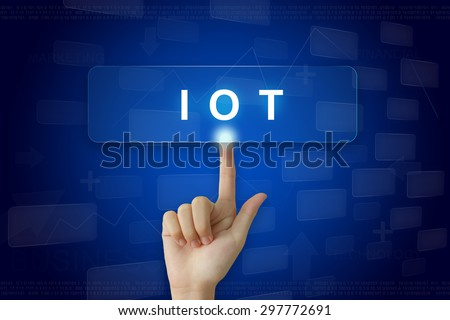 hand press on IOT or internet of things button on virtual screen - stock photo