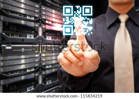 Hand press on QR code in server room
