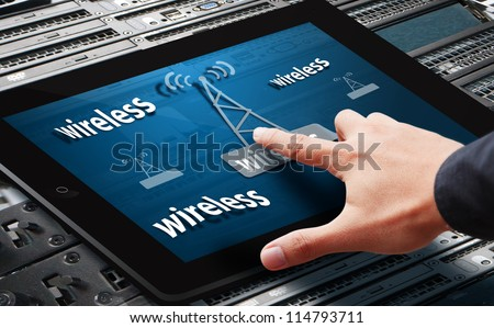 Hand press on signal wifi tower icon on tablet - stock photo