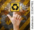 Hand press touch Recycle symbol on industry background - stock photo