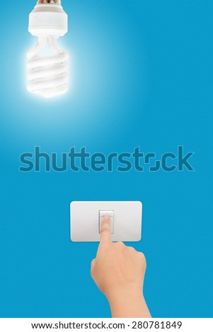 hand pressed to switch to turn off the light. - stock photo