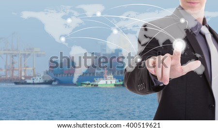 hand presses on world map ,Industrial Container Cargo freight ship at dusk for Logistic Import Export background (Elements of this image furnished by NASA) - stock photo