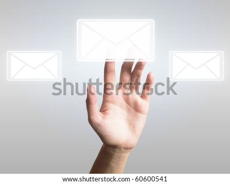 hand presses the button (icon of letter) - stock photo