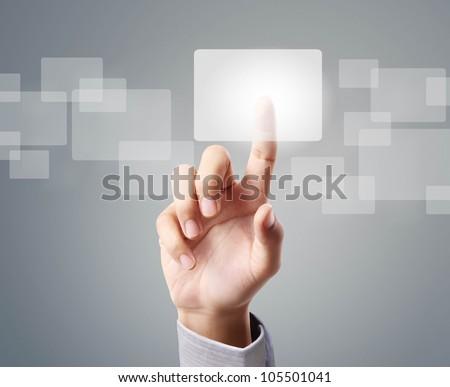 hand pressing a touchscreen button - stock photo