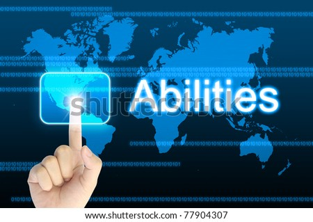hand pressing abilities button on a touch screen interface - stock photo
