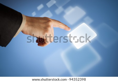 Hand pressing abstract virtual button on touchscreen - stock photo