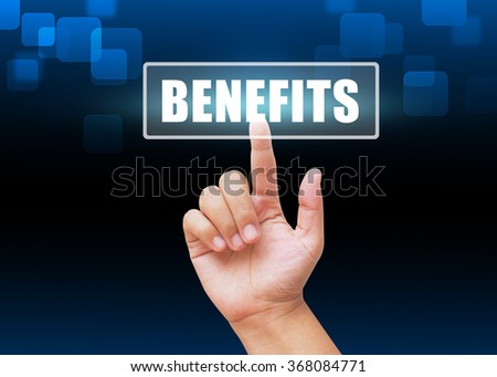 Hand pressing Benefits button with technology background - stock photo