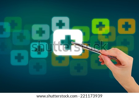 Hand pressing button with first aid sign - stock photo