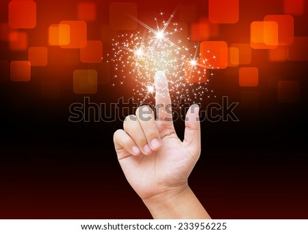 Hand pressing Christmas star buttons on holiday background - stock photo